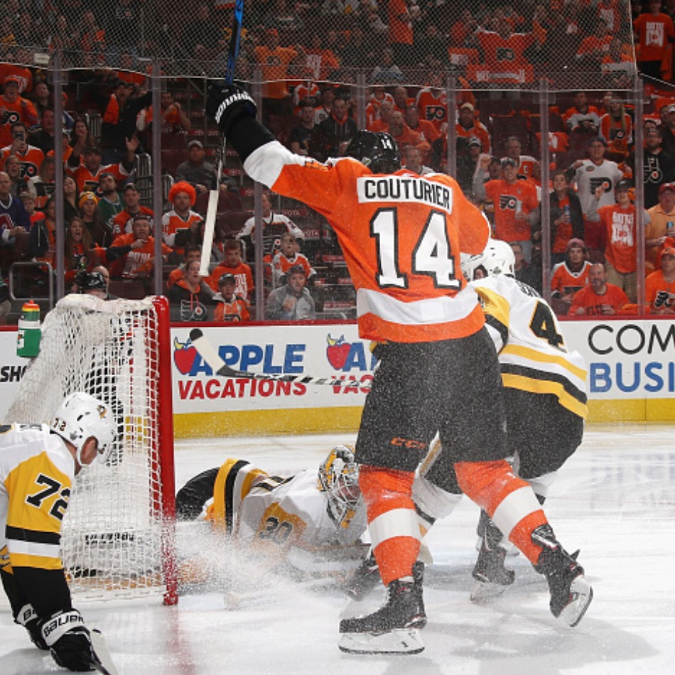 Sean Couturier hyping up the crowd at the Wells Fargo Center after scoring a goal.