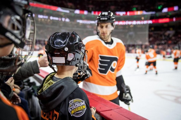 Flyers fans meeting player from the players bench